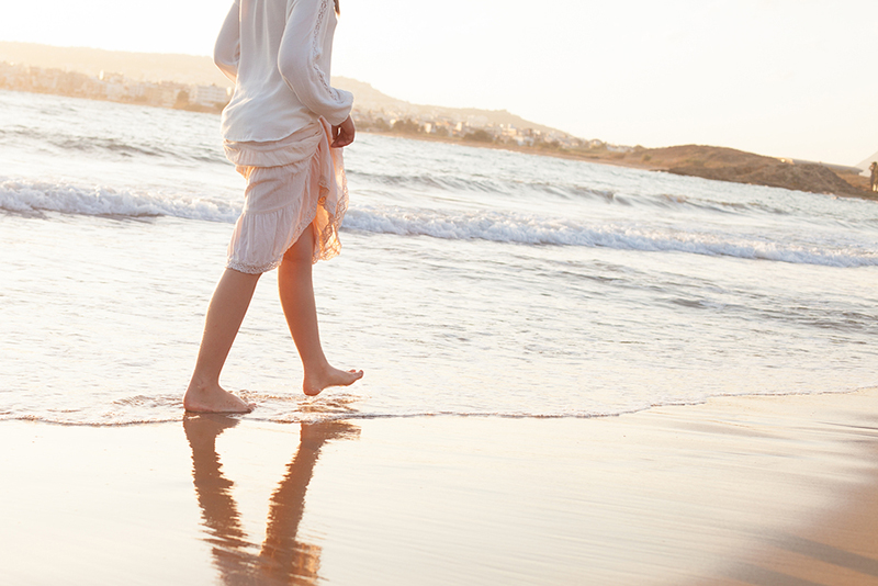 Woman walking along a beach