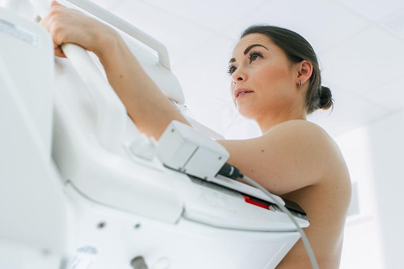 a woman getting a mammogram